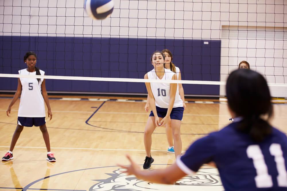 highschool volleyball match in gymnasium